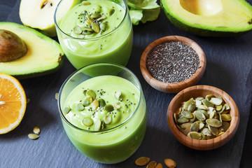 Fresh detox green smoothie with avocado, kiwi, salad with pumpki