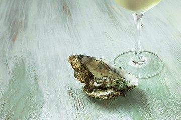 White wine and oyster photo with copyspace
