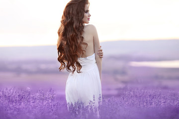 Beautiful young woman portrait in lavender field. Attractive bru