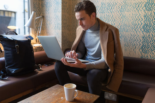 Young Businessman Working From a Coffee Shop