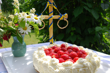 Cake with strawberries and cream at a table