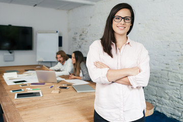 Young businesswoman looking the camera and smiling during a meeting work in office