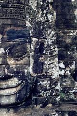Wall Mural - Ancient stone faces of Bayon temple, Angkor Wat, Siam Reap, Camb