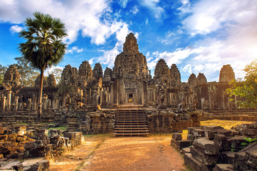 Ancient stone faces at sunset of Bayon temple, Angkor Wat, Siam
