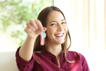 Happy owner or renter showing keys