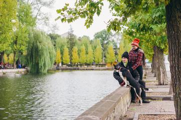 couple walking a dog park