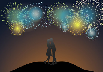 Young kissing under the light of fireworks.