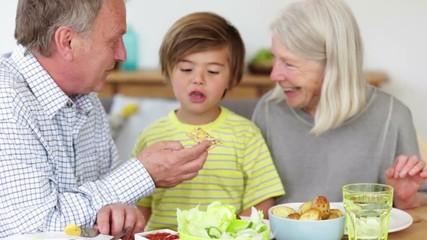 Image result for grandpa feeding a child