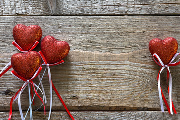 Valentine's day. Red hearts on wooden background closeup with copy space for congratulation
