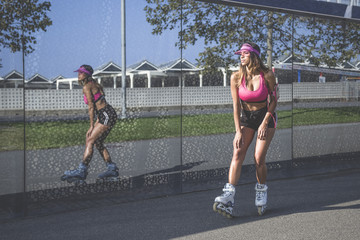 Beautiful girl skating on a sunny day