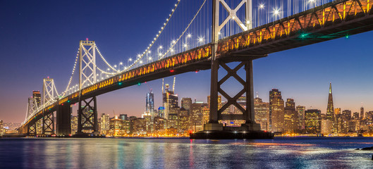 San Francisco skyline with Oakland Bay Bridge at night, California, USA