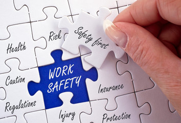 Work Safety Puzzle with female hand and text