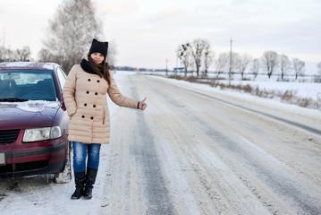 Broken car on winter road
