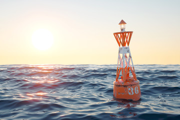 Buoy in the open sea on the sunset background.