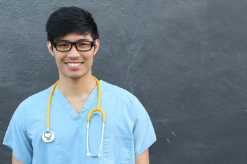 Handsome Asian Male Student Smiling on Gray with Copy Space