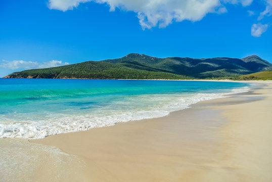 Scenic panorama of remote Australian beach with pristine white sand at Wineglass Bay, Freycinet National Park, Tasmania