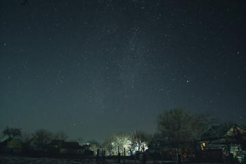 Winter starry sky in the village