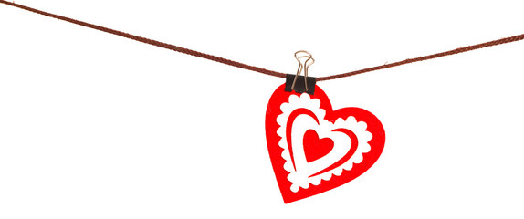 Red heart from dense fabric on a clothespeg on a rope