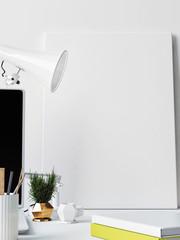 White Framed poster on working desk, 3d illustration