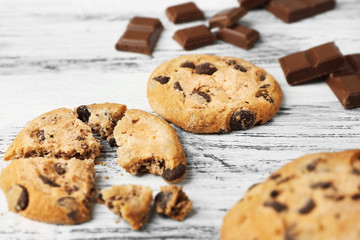Chocolate cookies on wooden background