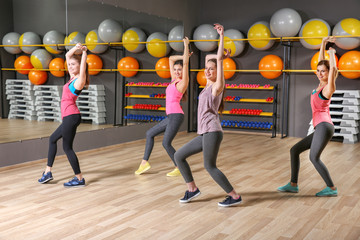 Young sporty women training in gym