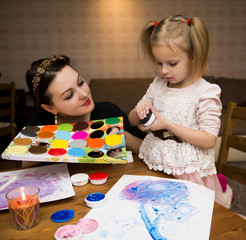 Mother and the daughter draw paints, house games with children