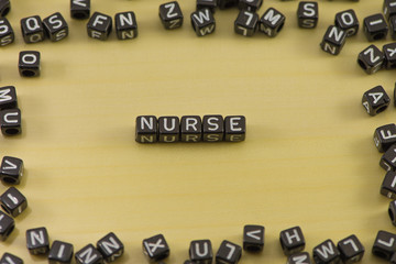 Word nurse on a wooden background