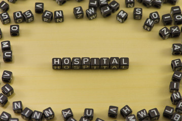 Word hospital on a wooden background