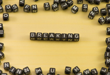 The word breaking on wood background