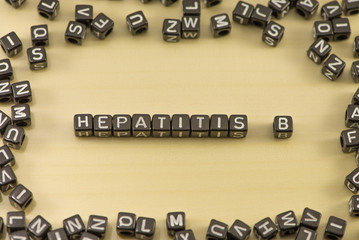 Hepatitis B word on a wooden background