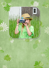 girl with camera in photo frame on green floral background