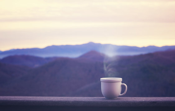 Morning coffe cup with alpine mountain view