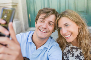 attractive young couple taking a selfie