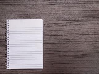 Dark Wood Desk, White Spiral Notebook