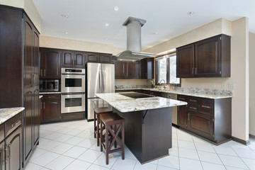Kitchen with stove-top island