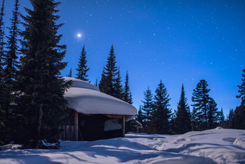 fabulous winter image of a wooden house with light