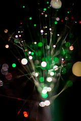 Colorful bokeh circle light celebrate at night, defocus light abstract green background.