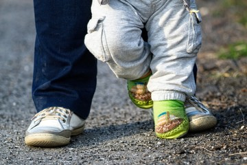 Happy feet - parent and child on the walk