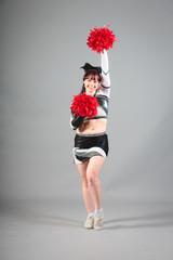 Studio Shot of Cheerleader Posing