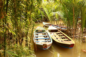 asian boat on mekong river close up photo