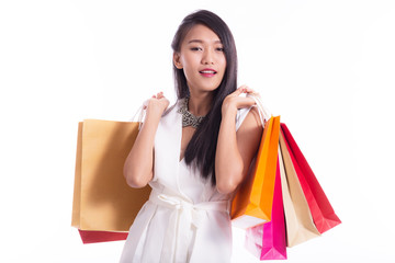 Beautiful Asian women holding shopping bags in her hands feeling so happiness isolated on white background with a copy space
