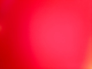 Blurry grungy abstract pink red background. Blurred surface