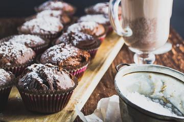 Homemade muffins and drinks in cups