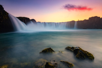 Scenic view of Godafoss waterfall during sunset