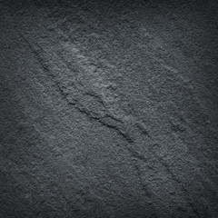 Dark grey black slate stone texture / stone background
