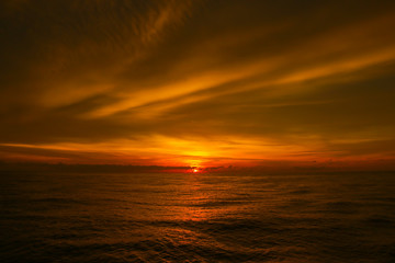 Scenic view of beautiful sunset above the sea. Beautiful cloud texture.
