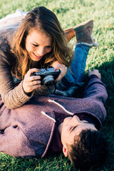 Playful couple with camera