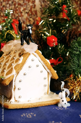 Gingerbread house and trees with Christmas gifts.