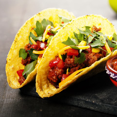 Mexican tacos with meat, beans and salsa