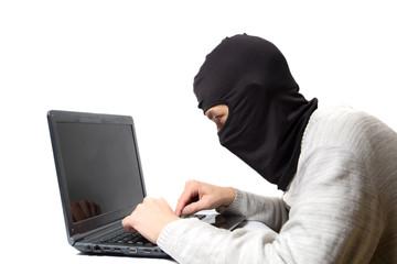 Hacker. Internet fraudster with a laptop